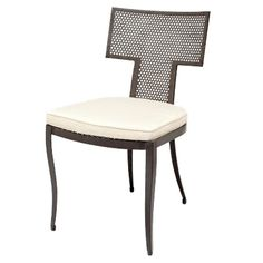 With the kismet-shaped Hadley, we've added a versatile option to our outdoor seating offering. Straight lines, a mesh back and seat, and curved legs combine to create a modern metal chair powder coated for protection against the elements. You can use the Hadley both indoors and out. It comes with a Sunbrella outdoor cushion.   Finish: Black Mesh Metal