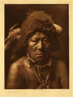 Bull Neck – Arikara: A member of the Buffalo order of the medicine fraternity. Bull Neck is portrayed wearing his head-dress of buffalo horns and hide. 1908. Edward Sheriff Curtis Photography.