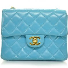 This is an authentic  CHANEL Vintage Lambskin Quilted Mini Flap in Turquoise GHW.   The bold design and exceptional quality of this vintage Chanel mini shoulder bag lend a look of chic sophistication for day or evening.