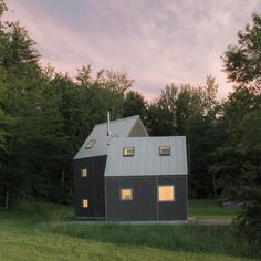 Pointy roofs and square windows that frame views of the landscape figure into this pine-clad retreatin the northeastern US,by design studio New Affiliates