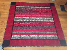 Jelly roll quilt: red, black, and white