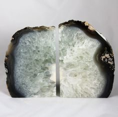These bright white agate bookends are a wonderful natural touch for any room! The agate has a beautiful organic design and these are truly one-of-a-kind!! The bright white of the stone will blend in seamlessly with any style of home decor. Store your books in style with elegant accents! This pair is 5″ tall, 7 1/2″ wide and 2 1/2″ deep.