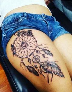Sexy Dreamcatcher tattoos on the thigh.