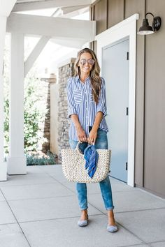 Blue and white stripe shirt, blue jeans, and straw bag is a perfect cute, casual summer outfit