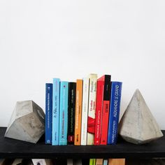 Give your bookshelf a modern twist with geometric concrete bookends.