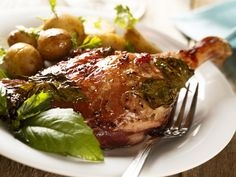 Roasted duck legs can be seasoned with simple ingredients like thyme or spiced up with fall foods like apples and cranberries. A layer of crispy skin on their outside makes them all the more delectable.