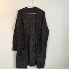 Trouve Oversized Open Sweater Black, white and grey. 55% cotton, 26% acrylic, 18% poly. Pockets on each side. Some piling due to wear but nothing out of the ordinary. Very good condition Trouve Sweaters