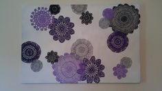 Made on a large canvas with crocheted doilies painted different colors to match my bedroom. I love it! :)