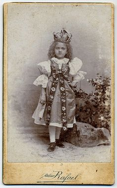 Královnička (Little Queen).  This girl is dresed in the folk costume of the moravian region Haná. Královnička (Little Queen) is a main figure of the folk feast at Pentecost, circa 1900.