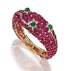 18 Karat Gold, Ruby, Emerald and Diamond Bracelet,    France, Circa 1945  Estimate: 15,000 - 20,000 USD  LOT SOLD. 20,000 USD (Hammer Price with Buyer's Premium)