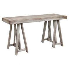 Teak wood console table with trestle legs and a vintaged finish.  Product: Console tableConstruction Material: Teak woodColor: Vintage greyDimensions: 31 H x 65 W x 21 DCleaning and Care: Remove dust with a soft, lint free cloth