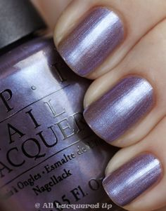 """OPI """"The Color To Watch"""" a murky lavender shimmer with a blue sheen."""