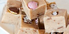 A delicious indulgent and easy Creme Egg fudge - perfect for using up any squished eggs this Easter! Topped with mini eggs for a crunchy finish.