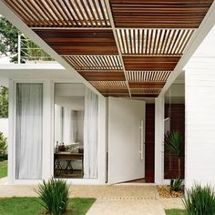 Summer style!! Mid Century Modern Front covered entrance! Love the wood panels!