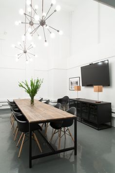 """In the """"Fish Bowl"""" meeting room, the ceiling opens to the mezzanine level, allowing employees to peer in from the top. Bluecore wants to encourage transparency within the company. Quite a shift from the secret dealings of the building's Prohibition past."""