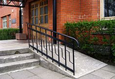 Building entrance with ramp for disabled person wheelchair by Grandpa, via ShutterStock Concrete Patios, Porch With Ramp, Ramp Stairs, Handicap Ramps, Ramp Design, Access Ramp, Easy Access, Front Steps, Front Entrances