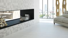 Living room with a wall fireplace featuring our new Cast series. The Cast series features colour body floor tiles in two colours to complement the wall tiles and one decorative pattern. Wall tiles available with various decors that have an understated 3D design. - See more at: http://olympiatile.com/product/series/795/cast#4024-cream