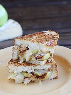 Pan-Roasted Apple and Brie Grilled Cheese - perfect as a cocktail party finger food, this sweet and savory recipe is one your guests won't soon forget.