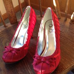 "Deb Red dressy shoes. Size  10. With heel. Satin look ,pretty dress shoes. Bow on front. Detail on shoes. Have 4"" heel, Deep red  in color. Very little wear. Deb Shoes Heels"