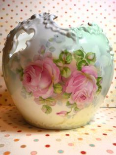 Hand painted roses on a fine porcelain rose  bowl