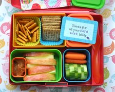 A healthy bento lunches for kids idea featuring Pepper Jack Cheez-its, Cracked Black Pepper Triscuits, Yogurt (in the lidded container), Gala apple wedges & caramel dip, baby carrots and checkered cucumber slices....For more ideas for school lunches visit http://school-lunch-ideas.net
