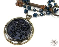 Victorian Necklace - Luxe Antique Button Jewelry - Blue Swarovski Crystal - Double Strand - Steel Cut Flowers Button Pendant. $112.00, via Etsy.