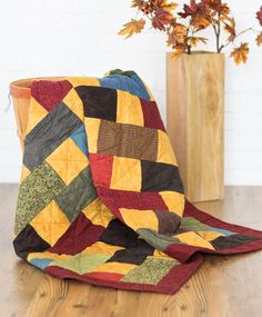 """Need a quilt in a hurry? Use pre-cut 10"""" squares and you'll have this one done in no time. Brick Work features assorted #flannel squares in dark autumn colors. Digital pattern and quilt kit available! Find this quilt in Quilting Quickly Fall '14."""