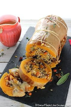 Stuffed Roasted Butternut Squash The perfect vegan centrepiece main dish for Thanksgiving Christmas or any holiday Stuffed with super flavourful wild rice cranberries wal. Vegan Thanksgiving Dinner, Vegan Christmas Dinner, Vegitarian Thanksgiving Recipes, Thanksgiving Sayings, Christmas Dishes, Tofurkey Thanksgiving, Vegetarian Christmas Main, Traditional Thanksgiving Recipes, Stuffing Recipes For Thanksgiving