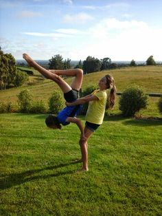 Two person acro stunts gymnastics