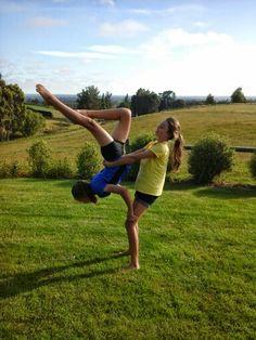 Two person acro stunts gymnastics