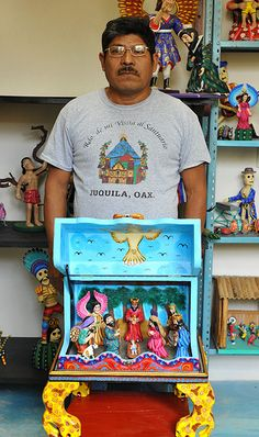 Master Woodcarver Agustin Cruz with his prize winning Nacimiento (nativity), Oaxaca
