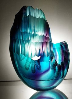 This is a Oceanvessel vase.I chose this due to its colors that blend in well with the other ones i found it extravagant the way the top has many elegant layers but then it gets smooth on the bottom.