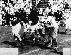 Photographer/Creator  James G. Conklin  Collection  1957  Publisher  Milwaukee Journal  Caption/Description  Football players not blocking the player with the ball. They appear to be tackling their own teammates.