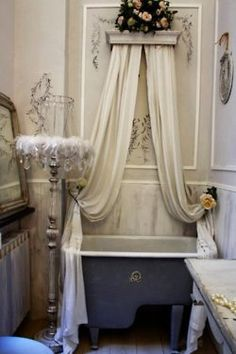 I like this piece of molding with the curtains.  I might do this above my bed and have the curtains drape around the mirror.  Or even above the vanity!