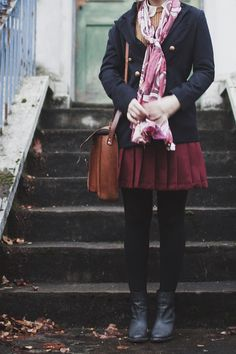Dresses on a Clothesline. navy wool coat and print scarf on brown sweater and cream collar, burgundy skirt, black tights and booties. adore this ensemble.