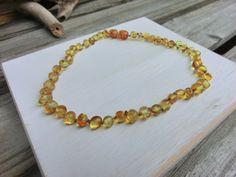 Baltic Amber Teething and Pain Relief Child's Necklace by OffOnAWhimJewelry on Etsy, $18.00