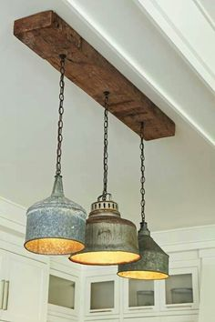 Love the re-purposed wooden beam and the milk can tops - totally awesome!