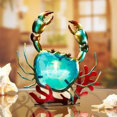 Colorful crab candle holder, hand sculpted from metal and glass.