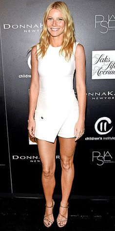 GWYNETH PALTROW A sleeveless white mini in October? If it works for Gwyneth, it works for us! Beachy waves and stripy bronze sandals top off her Versace dress at the PSLA Autumn party in L.A.