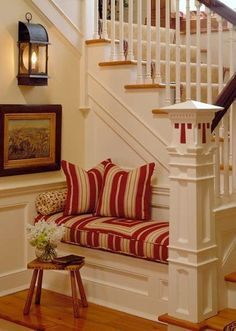 If I ever buy an old charming house with a wood staircase... Bench in the nook of staircase
