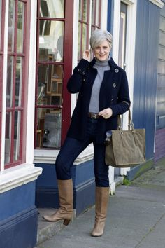 Beth Djalali-navy reefer jacket, jeans & blue-grey turtleneck, with coffee-colored boots.