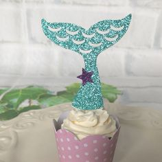 Mermaid tail cupcake toppers This listing is for 12 mermaid tail cupcake toppers -The toppers are double sided (back & front are the same) IIf you need a different color please send me a message. IMPORTANT: When making your purchase, please advise of your event date to ensure your items are completed and shipped with plenty of time. If your event date is less than 10 business days (M-F) away, please add to cart Upgrade my shipping and I will send it using priority mail (1-3 days)…
