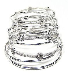 The Thea Bangle Bracelets in Silver in a classic shape add a dash of chic sophistication. Wear one, three or all nine for an on trend look! Silver Bangle Bracelets, Bangles, Bar, Chic, Metal, Classic, How To Wear, Color, Jewelry