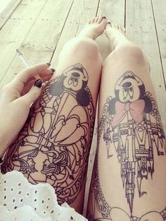 Disney Mickey Mouse and Minnie thigh tattoos. castle and beauty and the beast background.