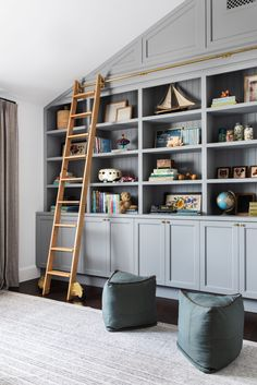 10 Really Amazing Blue-Gray Paint Colors in action Amber Interiors used Manor House Gray by Farrow Playroom Shelves, Blue Playroom, Corner Shelves, Playroom Organization, Playroom Paint Colors, Playroom Rug, Blue Gray Paint Colors, Neutral Paint, Rustic Beach Decor