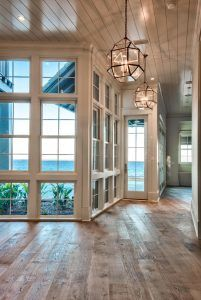Hardwood Flooring. Windows and hardwood Floors. The front door opens to a foyer with reclaimed plank wood floors. The front door opens to a foyer with reclaimed plank wood floors. Floors are Nikzad engineered, French White Oak, lightly wire brushed & naturally oiled. #window #hardwood #floors #Flooring #HardwoodFlooring Casey Joiner