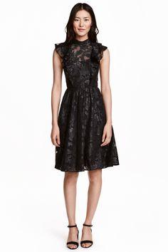 Jacquardgeweven jurk: Een midi-jurk van jacquardgeweven chiffon met…