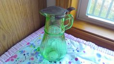 Vintage Hazel Atlas Vaseline Green Depression Glass Syrup Pitcher with Metal Top. Bottom is marked with the Hazel Atlas insignia. Measures 6