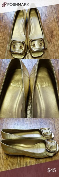 """Stuart Weitzman gold metallic flats Super cute ladies patent leather gold metallic open toe flats.  Size 7.  Approx 1""""heel.  Stuart Weitzman made in Spain.  Large gold buckle on top. These adorable flats can be worn with dresses or pants.  They have been worn but still in great shape with a lot of life left in them . Smoke free home!! Stuart Weitzman Shoes Flats & Loafers"""