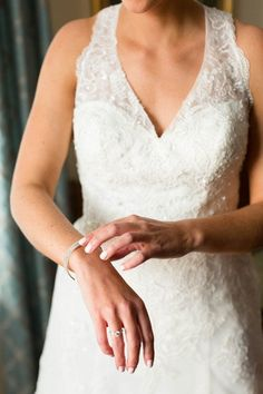 Wedding day accessories for bride - silver bangle to match silver engagement ring {Candice Adelle Photography}